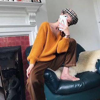 Orange v-neck knitwear