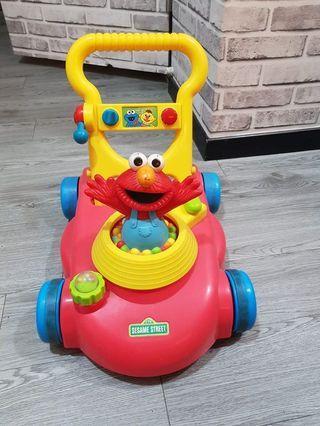 🚚 Preloved Sesame Street Elmo Grow and Go Walker Mower