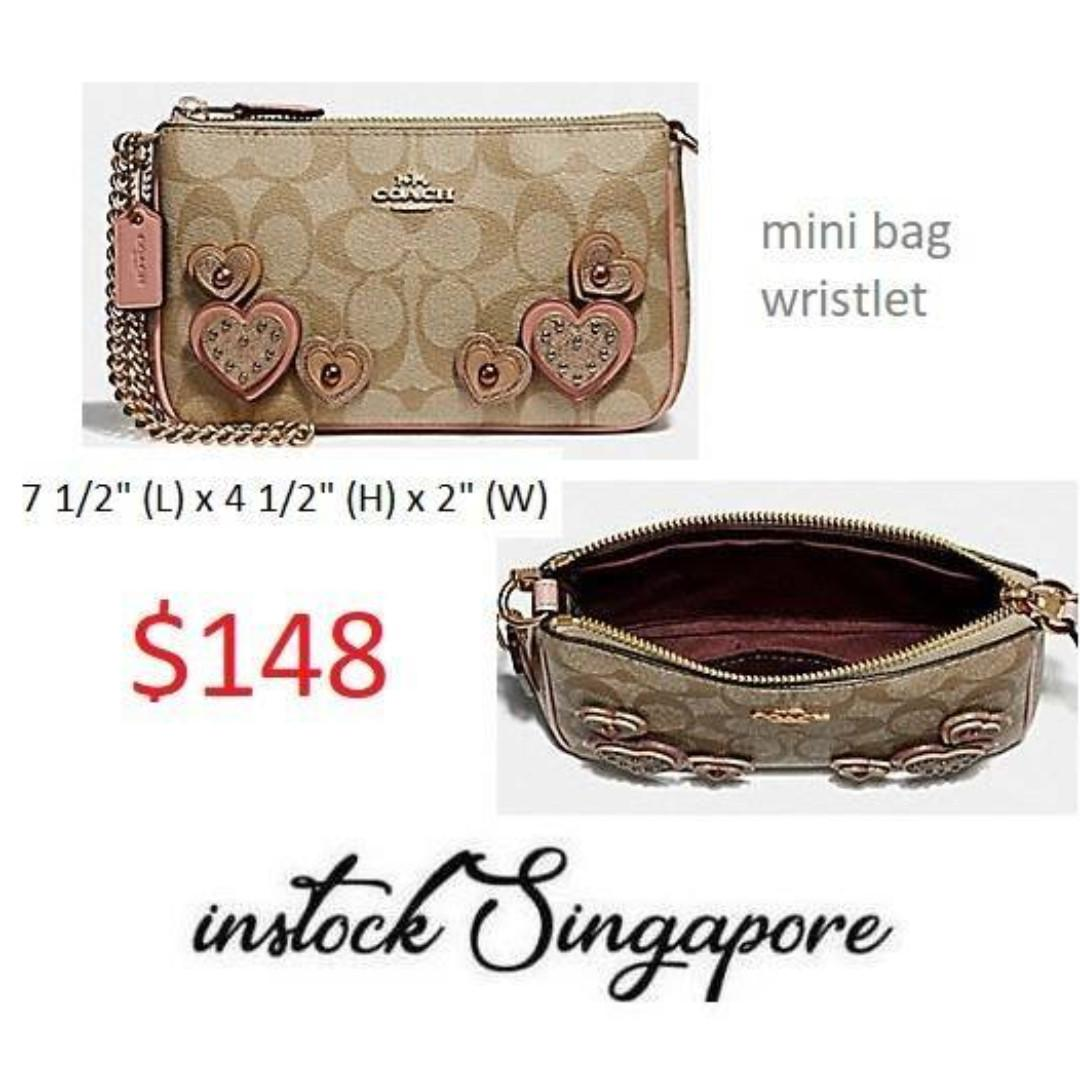 READY STOCK -AUTHENTIC - NEW Coach LARGE WRISTLET 19 IN SIGNATURE CANVAS WITH HEART APPLIQUE (COACH F67494)