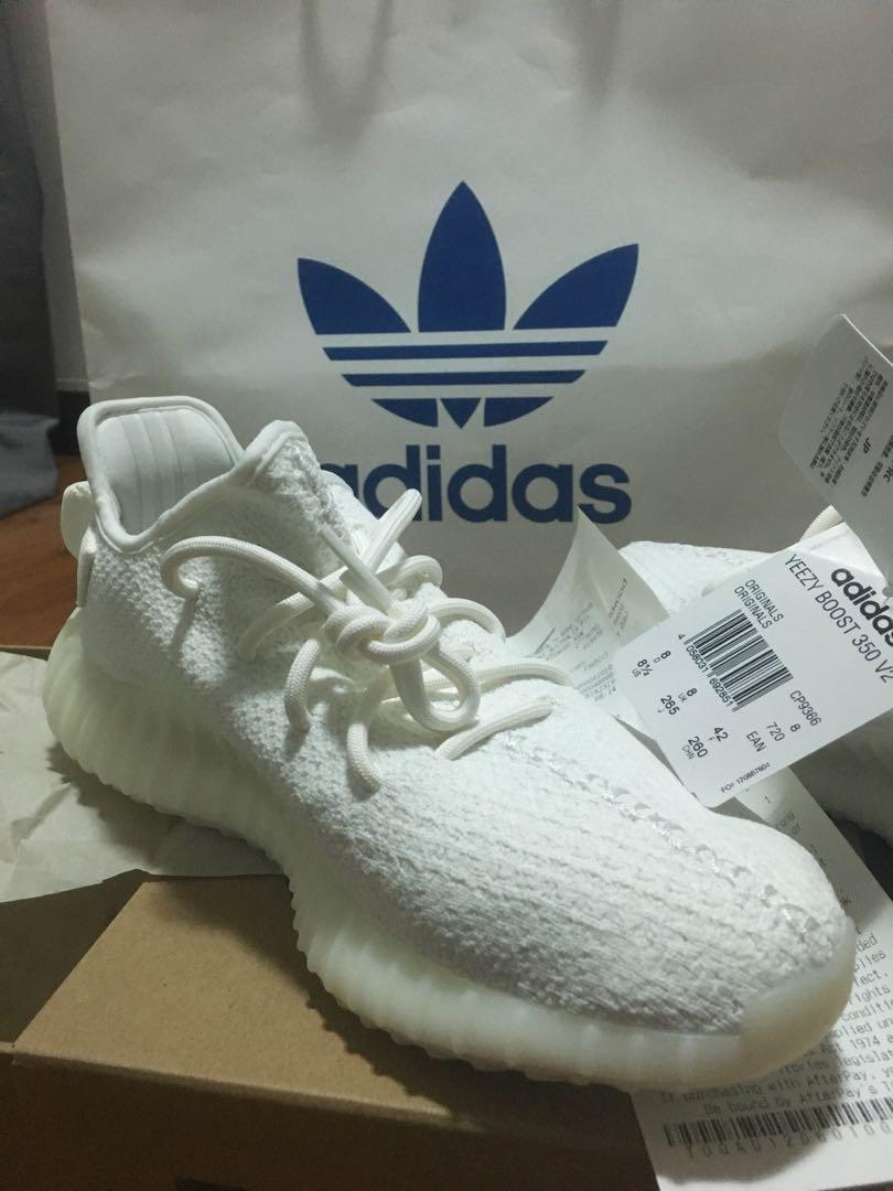 YEEZY TRIPLE WHITE BOOST 350 V2 size 8.5 BRAND NEW , NEVER USE