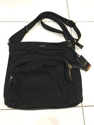 Authentic Tumi sling bag