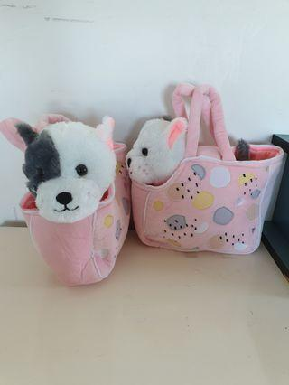 2 cute plush puppies with carry bag