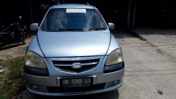 Kia caren II,manual,thn 2006