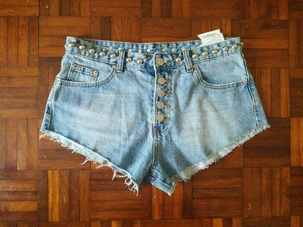 Blue short jeans with buttons