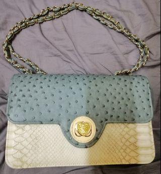 Ostrich and snake skin handbag.