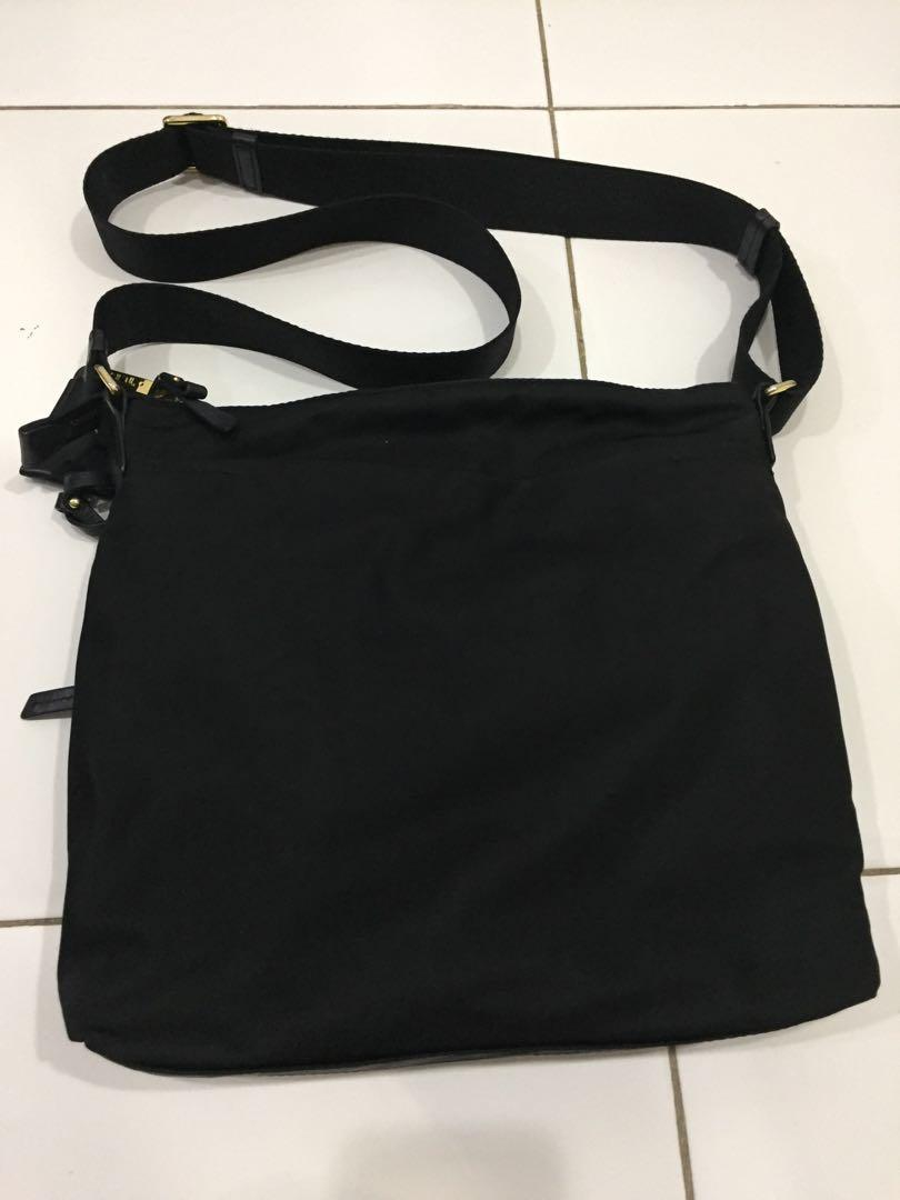 Authentic Tumi sling bag
