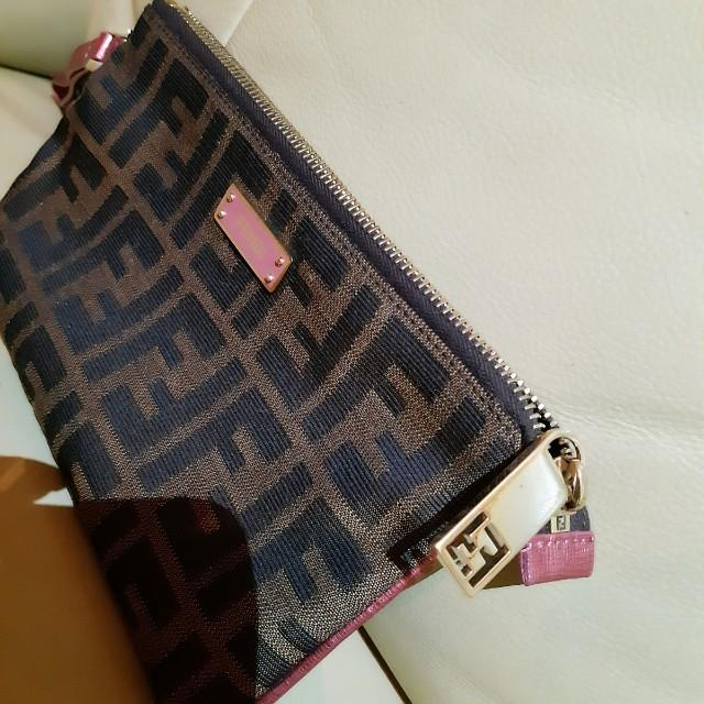 Full Set! 100% Authentic! Fendi Zucca Wristlet with Pink Trimming. Comes with Original Box, Dustbag and Receipt! Good condition, seldom used, moving house, priced to clear.