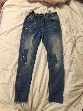 Zara blue jeans with paint patterns