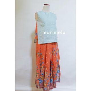 Beautiful orange batik  with statement, a dress combinaton