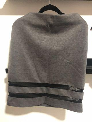 H&M Grey pencil jersey skirt with sheer bottom trims.