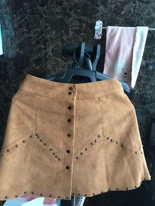 Leather skirt with metal decor