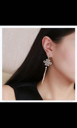 Classic dangling knot earrings