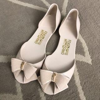 Authentic Salvatore Ferragamo beige jelly sandals with bows