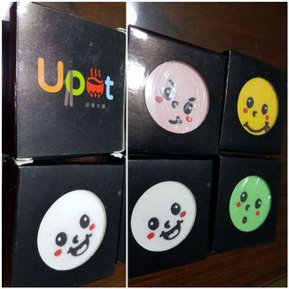 Upot keychains in box. Pink green white yellow. Different faces