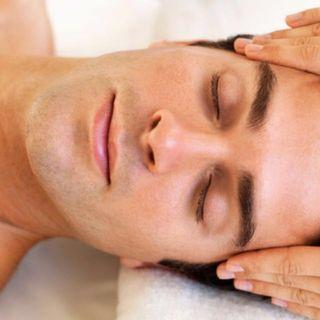 Man shoulder massage with facial and eye treatment