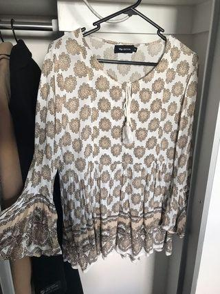 Cream and white patterned top