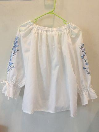 White off shoulder top with floral design