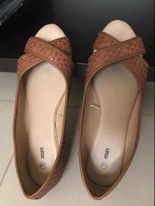 Brownish tan color slip on flat shoes