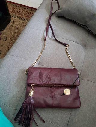 Oasis leather sling bag