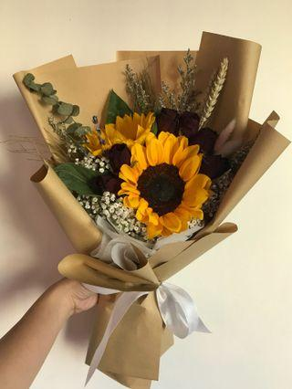 Sunflower and dried roses bouquet