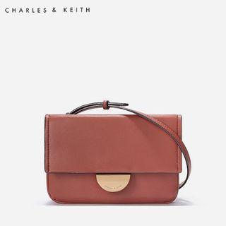 SAG6050 Brown Charles & Keith Metallic Accent Push Lock Pouch