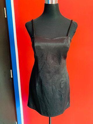 Plain black strap style dress