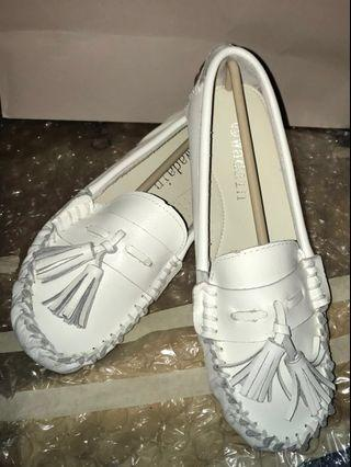 White faux leather flats