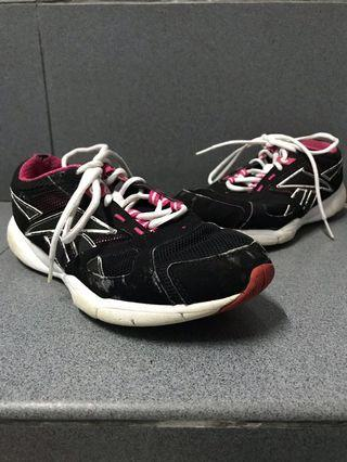 Black and pink Reebok running shoes