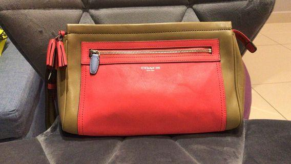 Coach Colorblock wrislet leather clutch . Seldom used . Excellent condition like new . With authentic card .