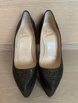 Christian louboutin black and gold gilter heels