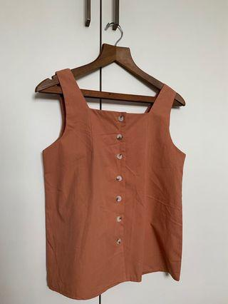 Basic buttoned top in burnt orange brown