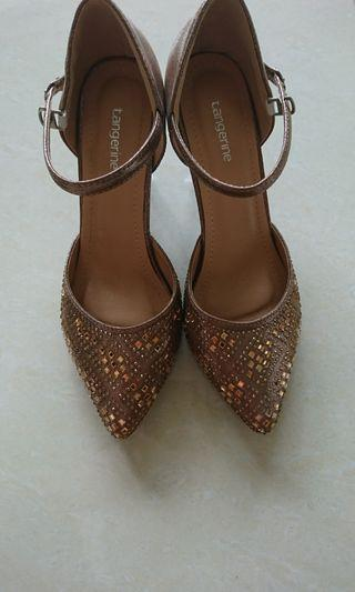 Brown color high heel shoes