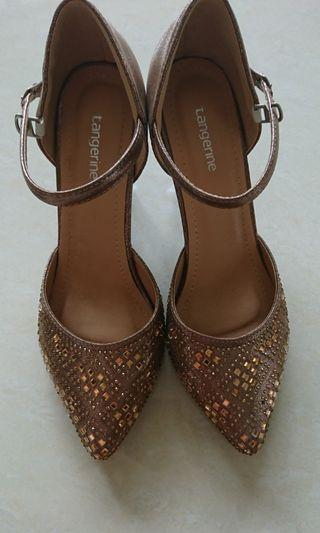 Brown color shining high heel shoes