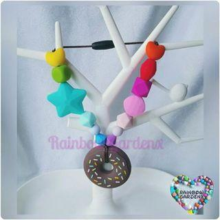 Customised handmade Brown Donut Teether with Rainbow beads Carrier Accessory