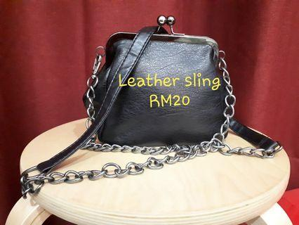 Leather pouch sling