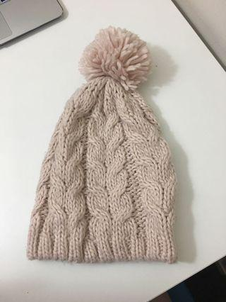 Pale pink cable knit pom beanie