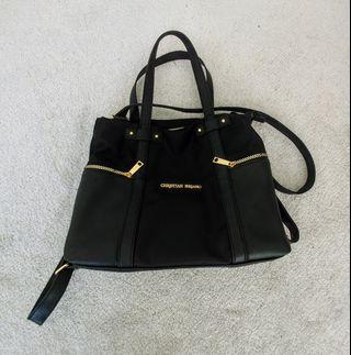 Black purse with leather and gold detailing