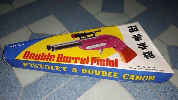 Pistol mainan lama