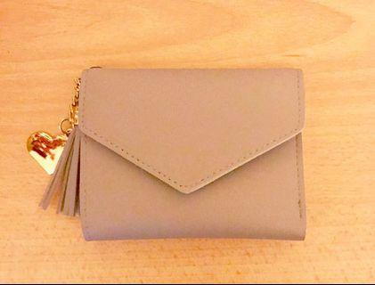 Light lavender mini wallet with card and banknotes slots
