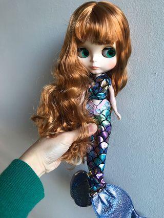 A Takara blythe Doll in a mermaid costume