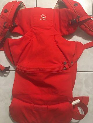 Brand new never used STOKKE mycarrier front baby carrier in red