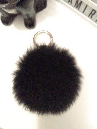Black fluffy Pom Pom