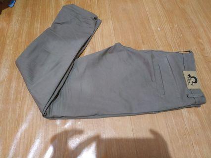 Celana chino libra cotton scotch dark khaki.