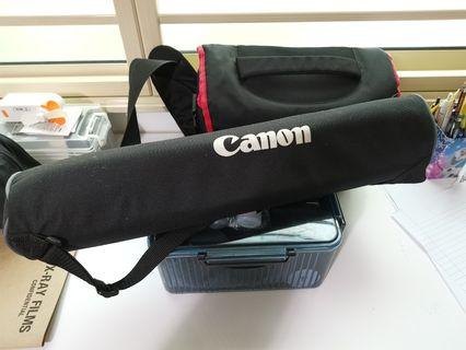 Cannon DSLR with tripod.