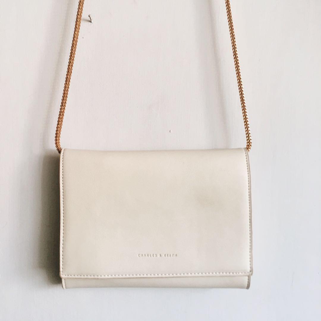 Charles & Keith Broken White Leather Sling Bag