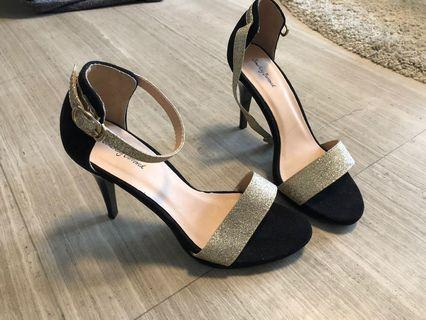 Black with gold glitter straps.