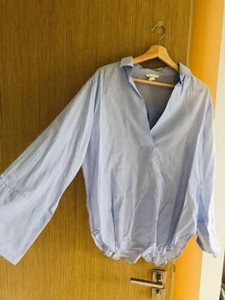 UK 12 H&M blue flare top that can fit size 14-16