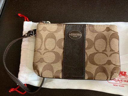 COACH Signature C Fabric with leather trim Wristlet