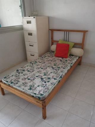Single bed and cupboard