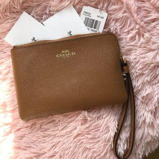 Brand new, 100% authentic COACH leather wristlet